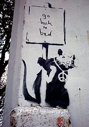 Stencil graffiti by Banksy
