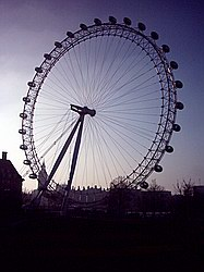 London Eye, silhouetted against the mid-afternoon glare