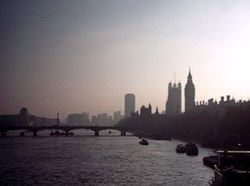 Big Ben and the House of Commons disappear in the sun's haze