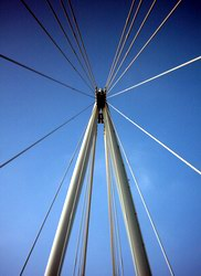Above your head, the Hungerford pedestrian bridge is held together at this point