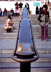 One of the handrails in Trafalgar Square: tourists at the top take photos