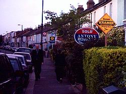 Orange Susan Kramer diamonds compete for space with estate agent signage