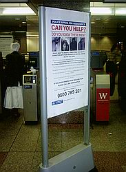 'Can You Help' sign on Tube with bombers' photos