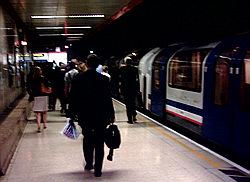 Commuters leaving the Waterloo and City line platform at Waterloo