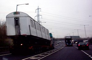 Tube train on the back of a lorry on the motorway: 2