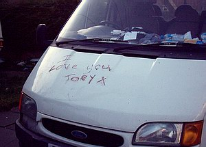 'I love you Joey' scrawled on a van bonnet, apparently in lipstick