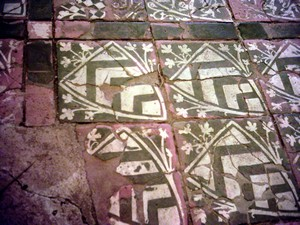 Heraldic tiles form a historic floor