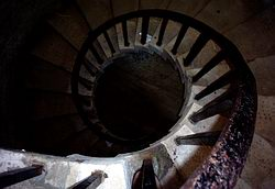 Looking down the centre of a spiral staircase