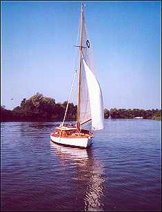 This lovely picture shows all the best characteristics of a Broads sailing yacht - forget about hiring any more motor cruisers!