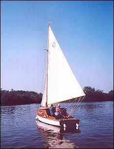 Leaving the island mooring on Malthouse Broad after coming in under sail. I'm taking the photograph, tutor Anton is on board with Lisa.